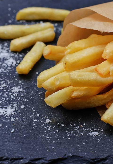 Duck fat fries on a slate board