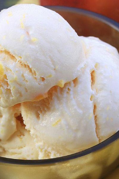 peach ice cream in a bowl
