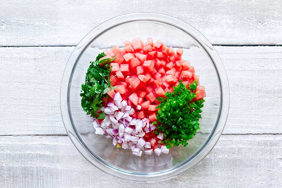 Ingredients for salsa in a bowl