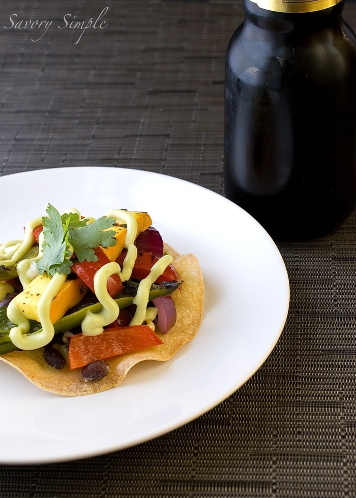 These grilled vegetable and black bean tostadas with avocado cream are a great summer meal!