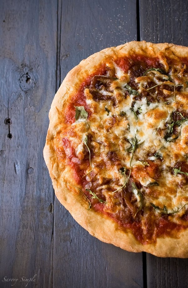 This caramelized onion arugula pizza is an excellent way to use up leftovers for an inexpensive dinner.
