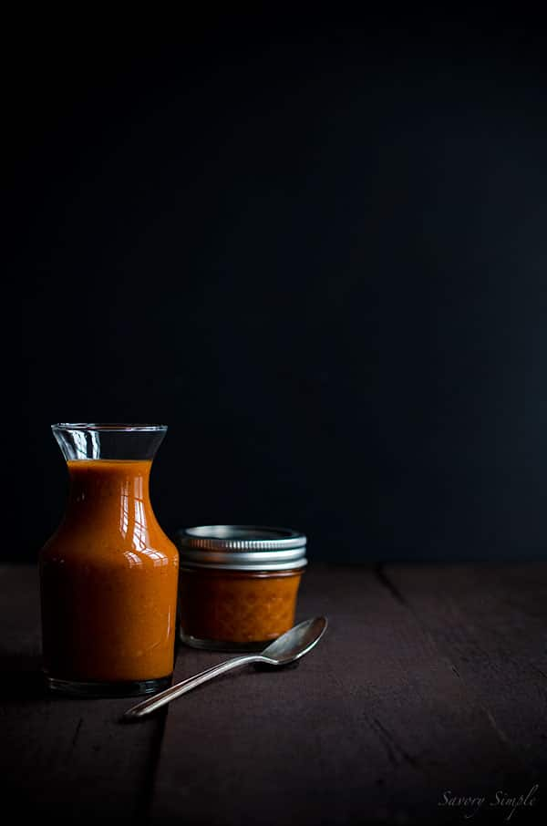 This All Purpose Roasted Tomato Vinaigrette is perfect for using on salads, eggs, sandwiches and even meat! It's tangy, rich and healthy.