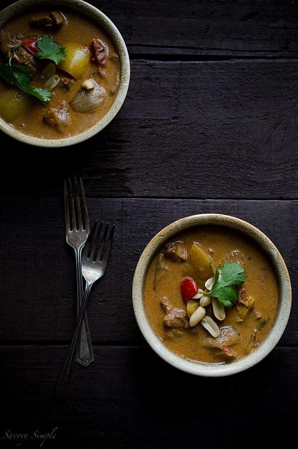 An overhead photo of chicken massaman curry in bowls
