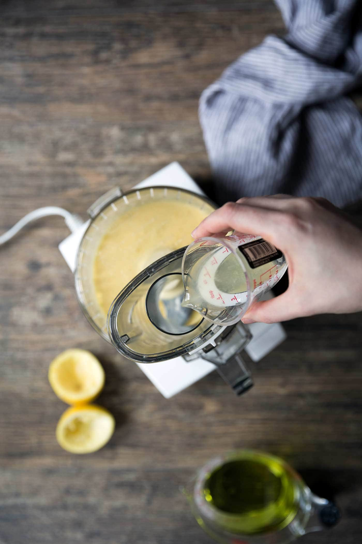 A photo of lemon juice being added to homemade mayo