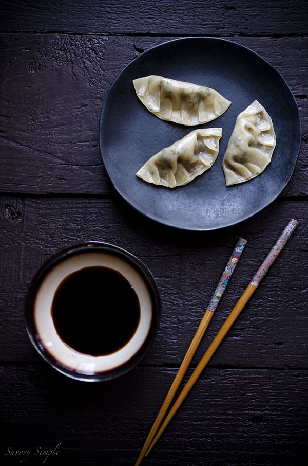 Cooked mushroom dumplings with dipping sauce.