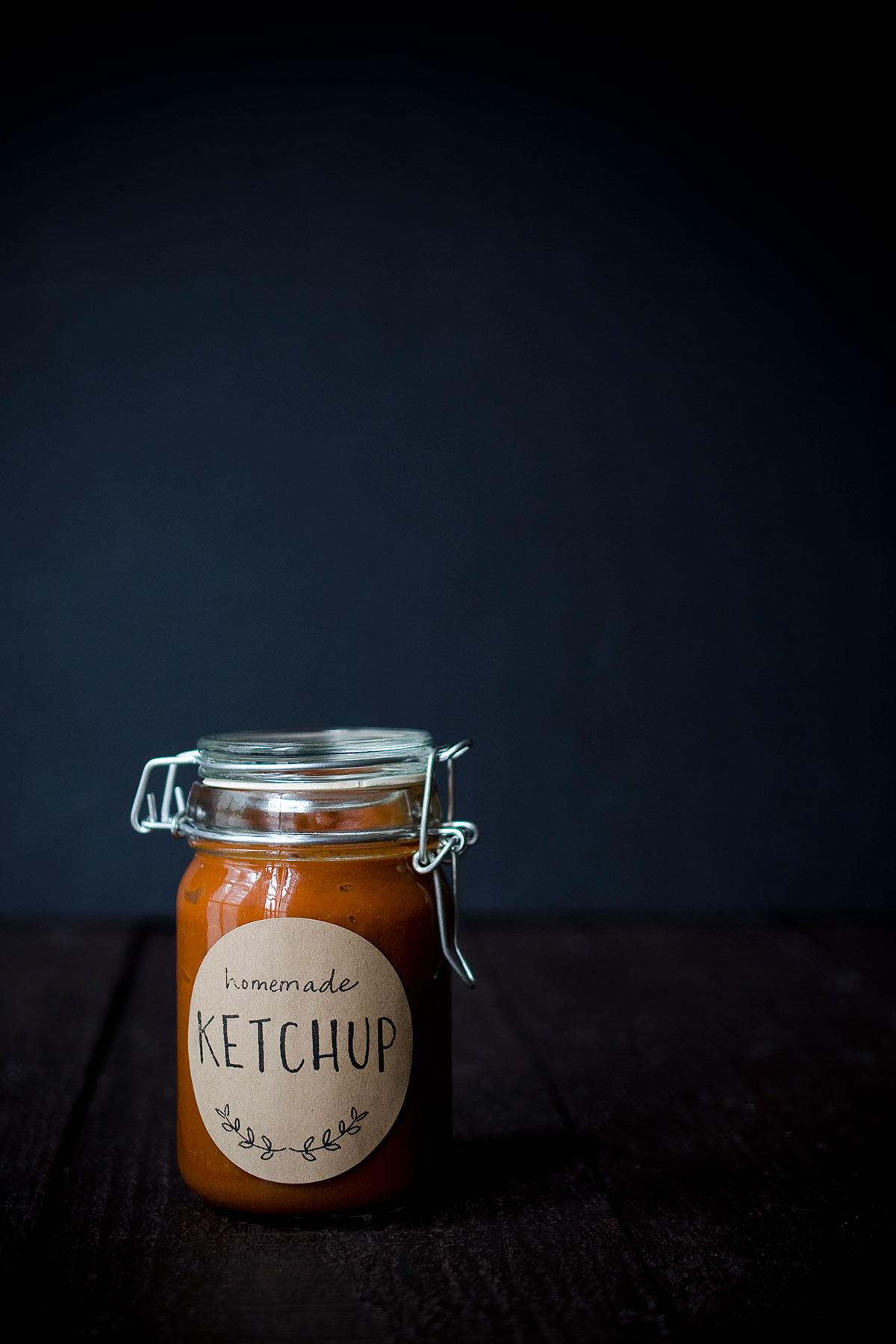 A photo of homemade ketchup in a mason jar