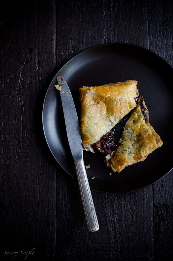 Macerated Cherry Nutella Pop Tarts are pretty much everything you want in a dessert: flaky pastry, creamy chocolate and a boozy fruit filling!