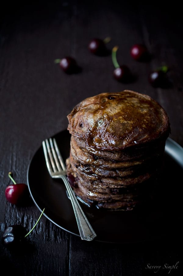 These decadent Chocolate Cherry Pancakes are thick, fluffy, and perfect for summer brunch.