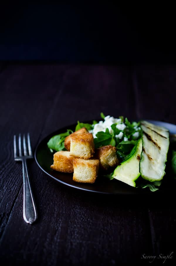 This Grilled Zucchini Salad with Feta and Sweet Croutons offers a perfect balance of flavors.