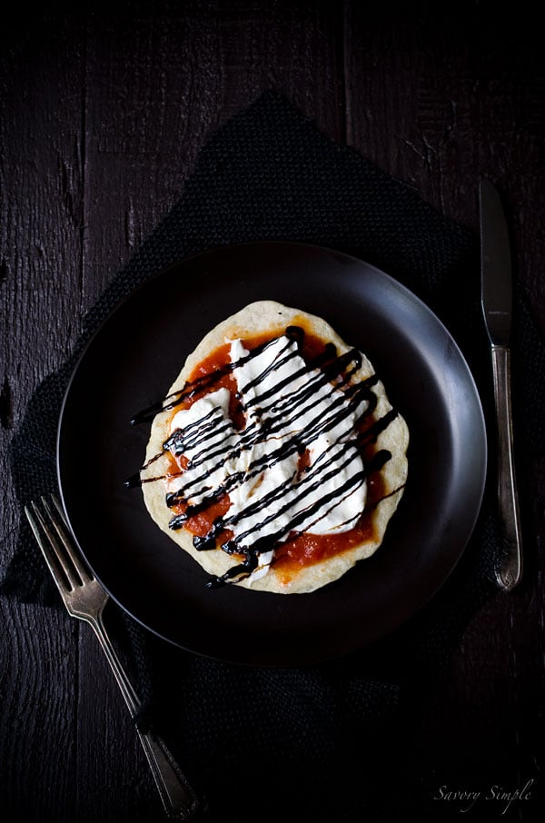 These individual pizzas with pomodoro sauce, burrata cheese and balsamic glaze are a perfectly portioned meal.