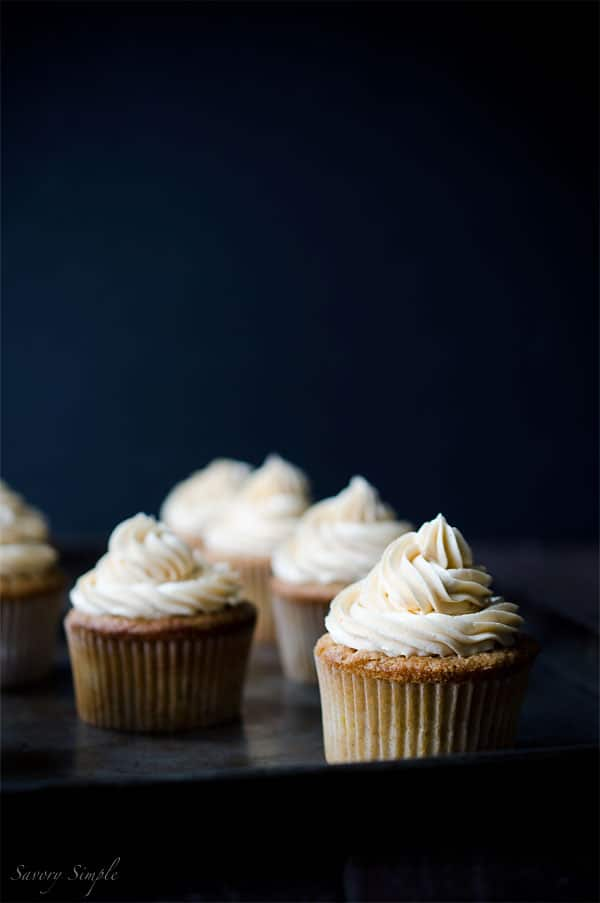 Summer peaches, boozy buttercream... what more does one need in a cupcake? You NEED these Peach Bourbon Cupcakes from Savory Simple!