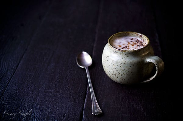 This spicy chocolate latte from Savory Simple will warm you up when it's chilly outside! This vegan latte uses almond milk, but regular milk may be substituted.