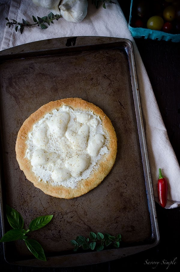 This Gluten-Free Four Cheese White Pizza is completely grain free but you'll never know the difference! Easy and delicious.