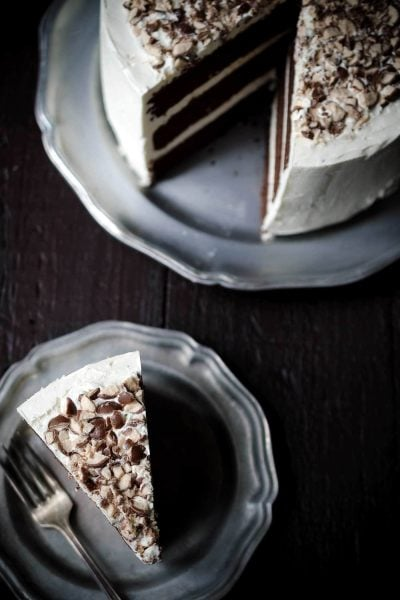A photo showing a slice of chocolate malt layer cake.