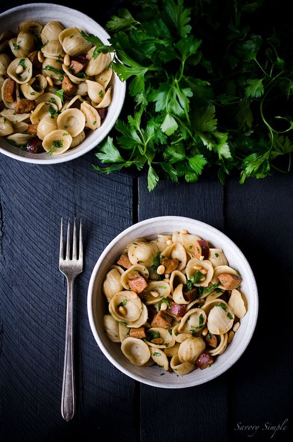 This recipe for Orecchiette with Andouille Sausage, Pine Nuts and ...