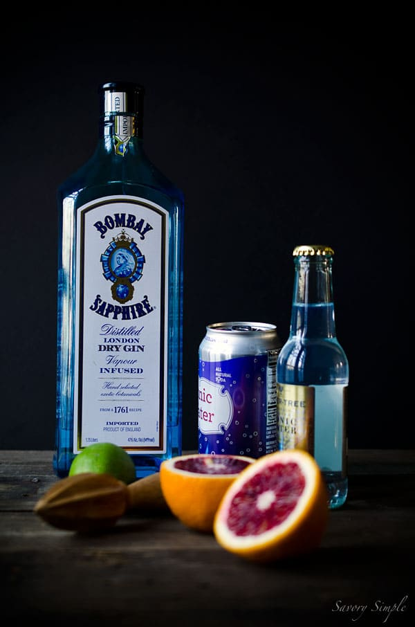 Photo of Gin & Tonic ingredients, including Bombay Sapphire Gin, Whole Foods Tonic, and Fever Tree Tonic, lime.