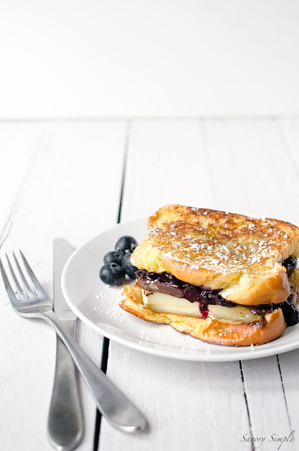 Grilled Brioche with Brie, Dark Chocolate and Blueberries is amazing for dessert or brunch! Get the recipe from SavorySimple.net