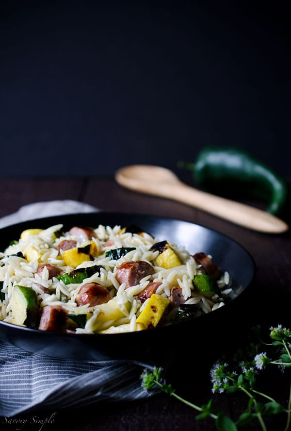 This Grilled Italian Sausage and Vegetable Orzo Salad is all about summer grilling! Smokey, charred vegetables add a ton of flavor to this meaty pasta salad. It's ready in just 30 minutes. Get the recipe from SavorySimple.net.