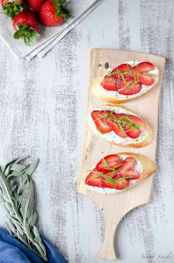 Strawberry Ricotta Crostini with Fresh Herbs is a light and refreshing summer appetizer that's easy to prepare and perfect for guests. Get the recipe from SavorySimple.net