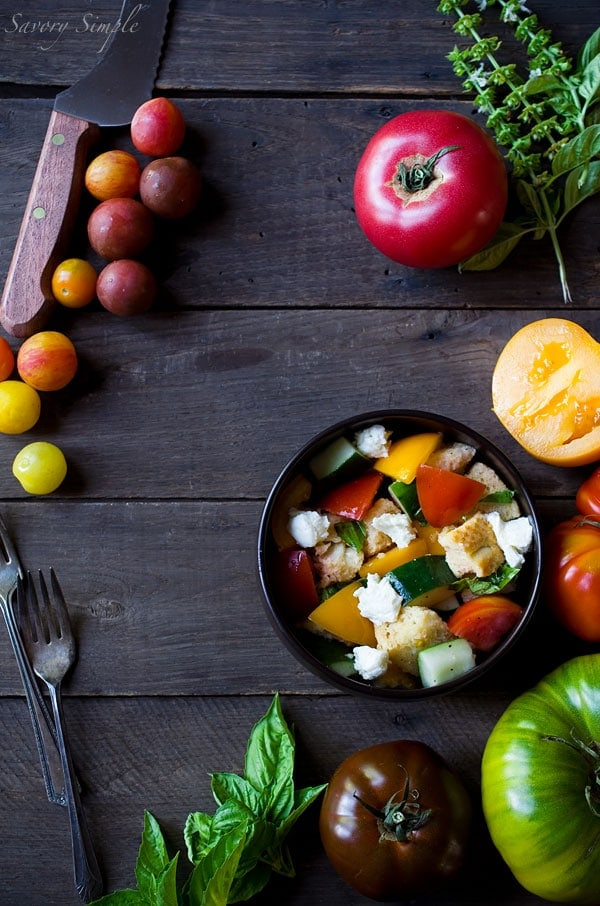 This Heirloom Tomato Panzanella Salad is a perfect way to enjoy summer's most beautiful tomato! Get the recipe from SavorySimple.net