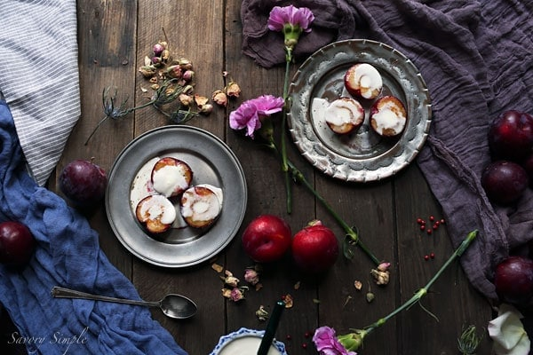 These roasted plums with creme fraiche are a simple, elegant dessert! Brown sugar adds just the right amount of sweetness. Get the recipe from SavorySimple.net.