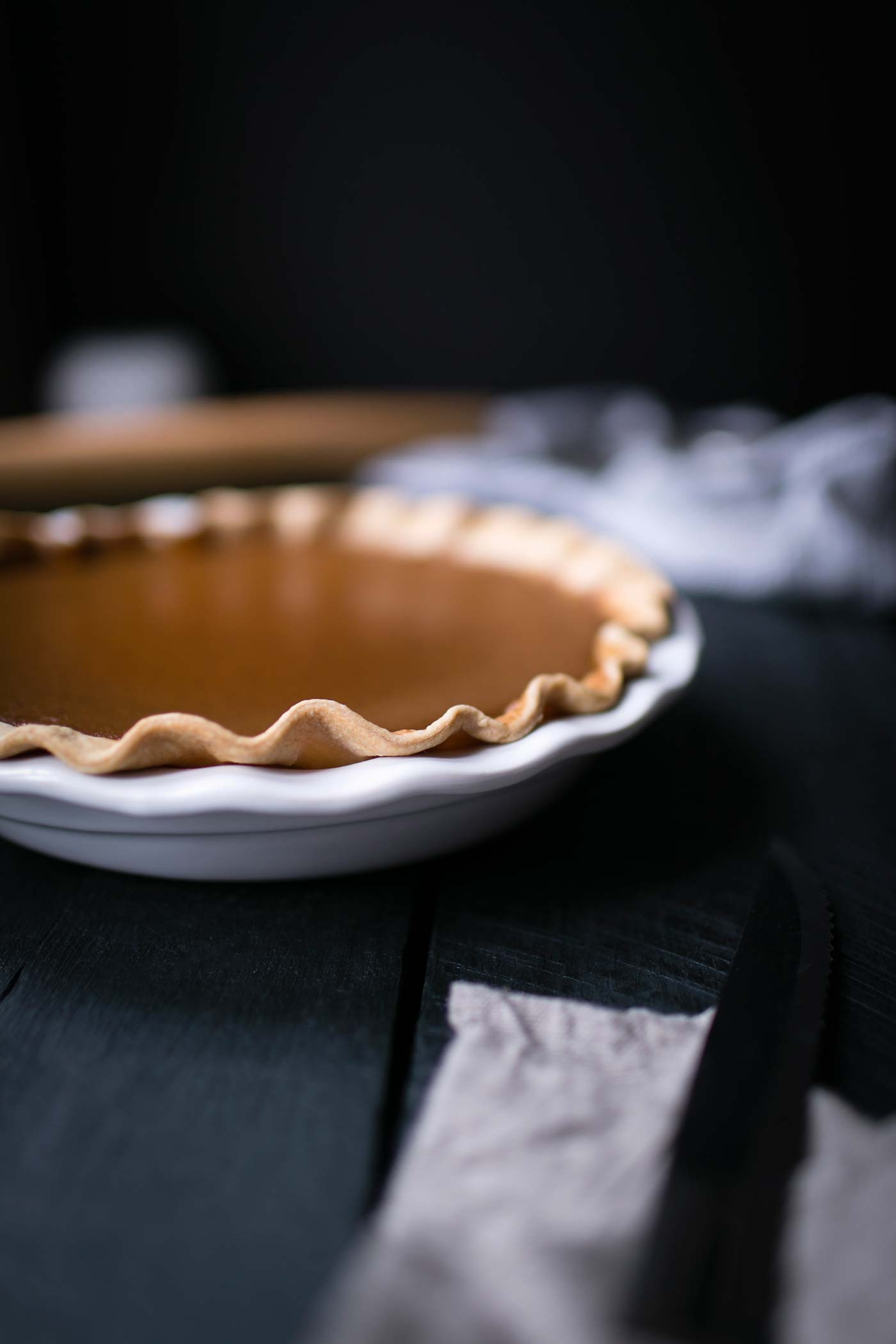 This Brandied Acorn Squash Pie is perfect for Thanksgiving! Acorn squash is naturally sweeter than pumpkin and works amazingly well in desserts. Get the recipe from SavorySimple.net.