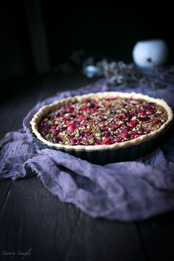 Serve this flavorful Cranberry Pecan Tart at holiday parties! It's perfect for Thanksgiving. Get the easy-to-prepare recipe from SavorySimple.net