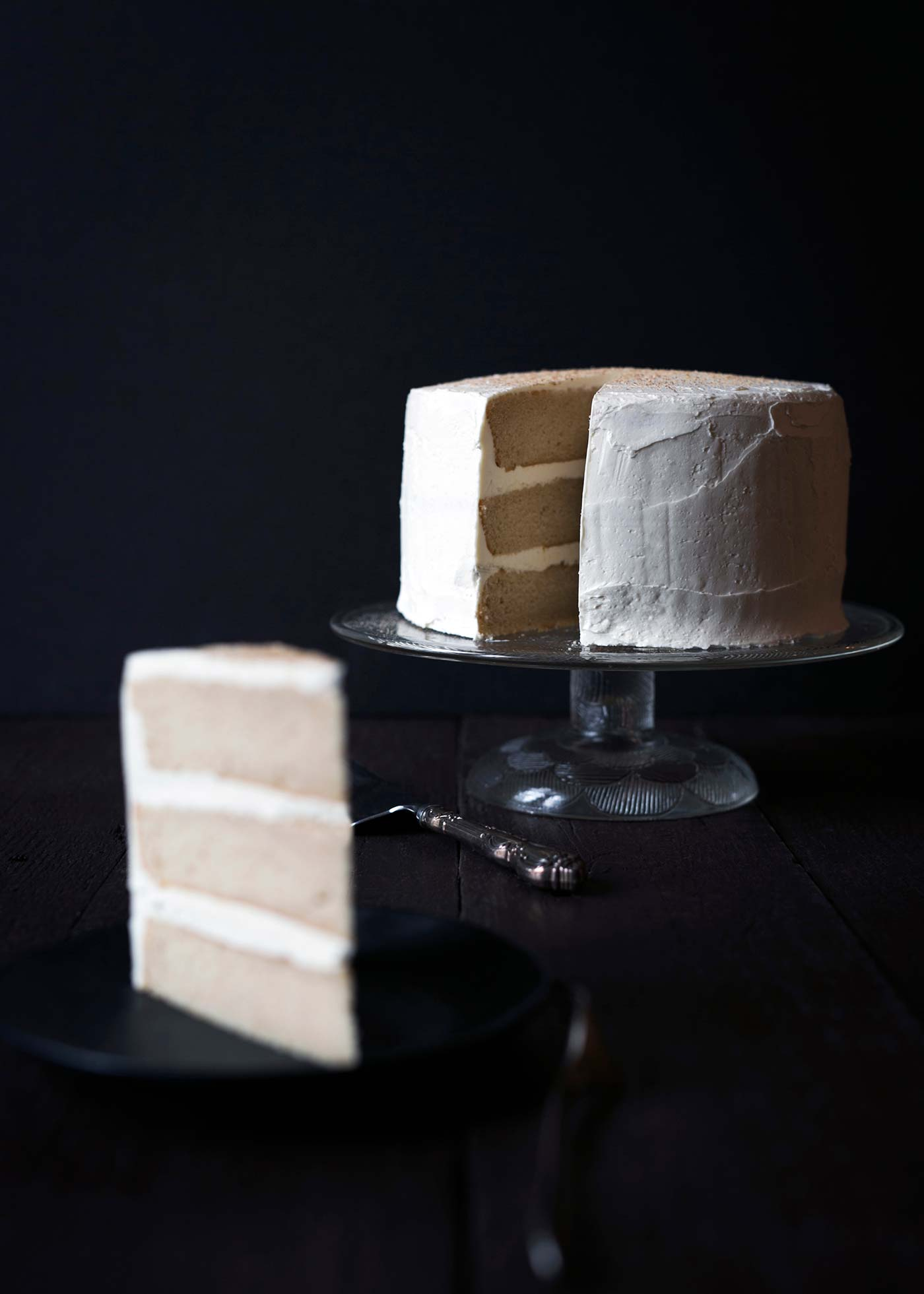 Impress your guests with this gorgeous and impressive Eggnog Rum Layer Cake! It's perfect for holiday parties. Get the recipe from SavorySimple.net