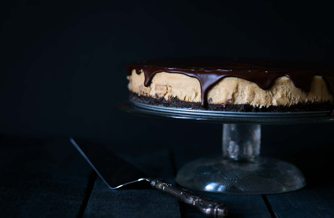 This decadent Chocolate Peanut Butter Cheesecake has a chocolate graham cracker crust, a light and fluffy peanut butter filling, and is topped with a bittersweet chocolate ganache. Get the recipe from SavorySimple.net