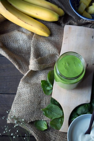 This is the BEST green smoothie i it's sweet, healthy and filling. Ingredients include bananas, yogurt, pineapple, mango and spinach (which you cannot taste)! Get the recipe from SavorySimple.net.