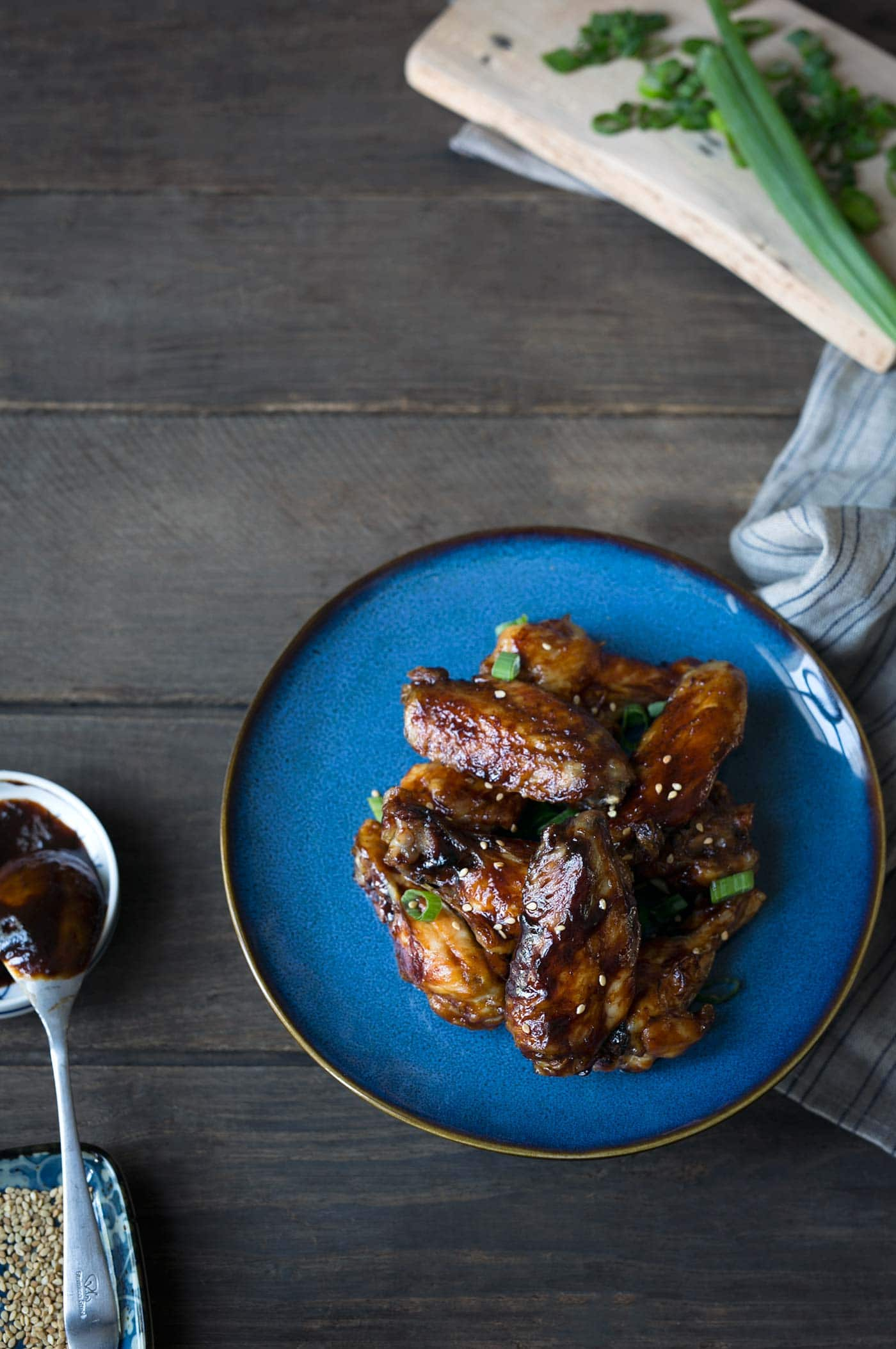 Sesame Hoisin Wings are easy to make and PERFECT for game day! They're baked, not fried, but the meat falls right off the bone. Get the recipe from SavorySimple.net