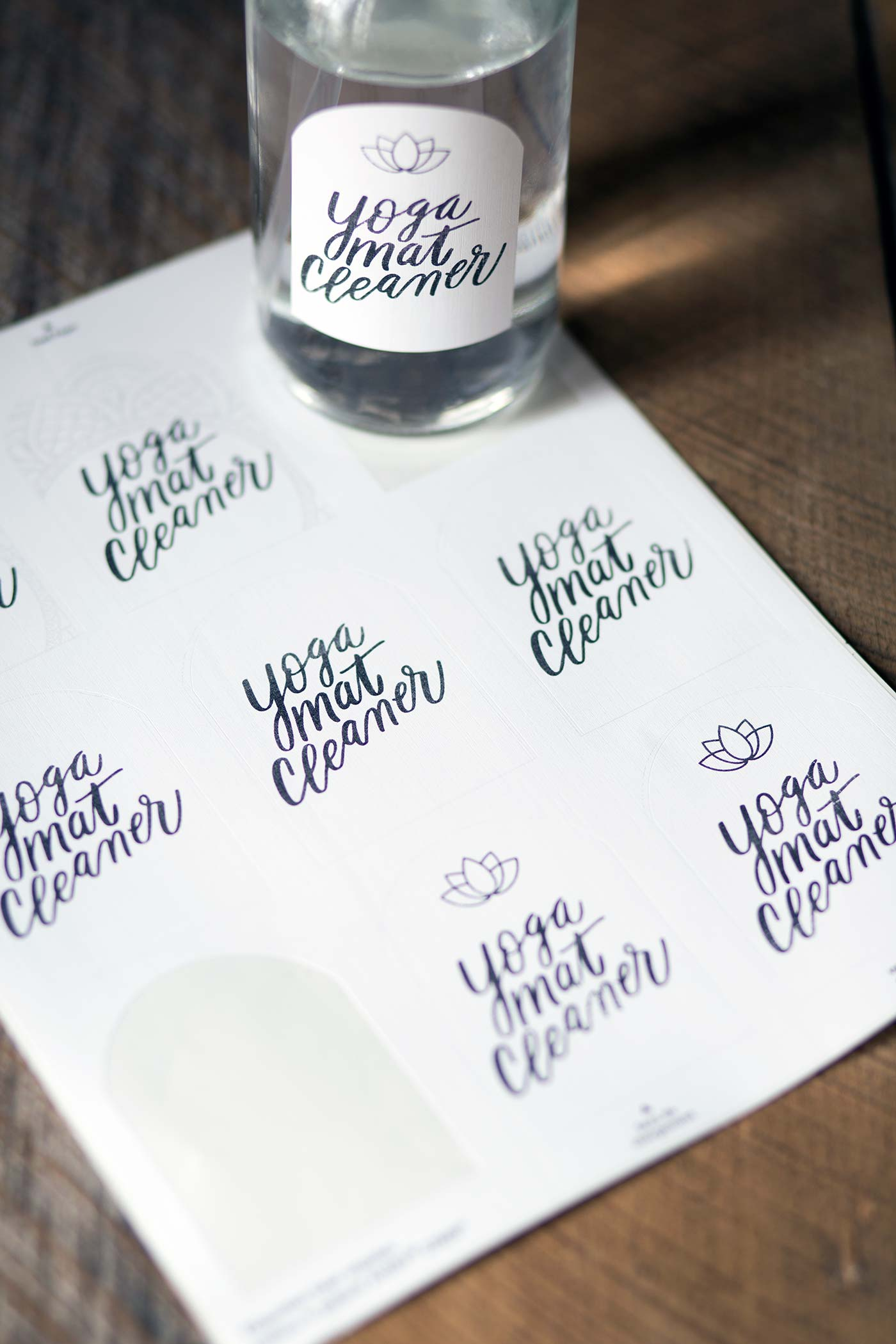 A photo of homemade yoga mat cleaner and free printable labels.