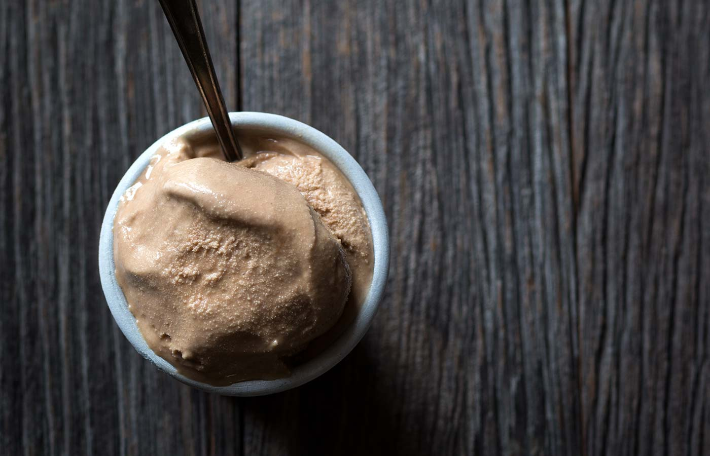 You don't want to miss this incredible recipe for Malted Milk Chocolate Bourbon Ice Cream. It's a decadent, boozy treat that's perfect for homemade ice cream lovers. SavorySimple.net.