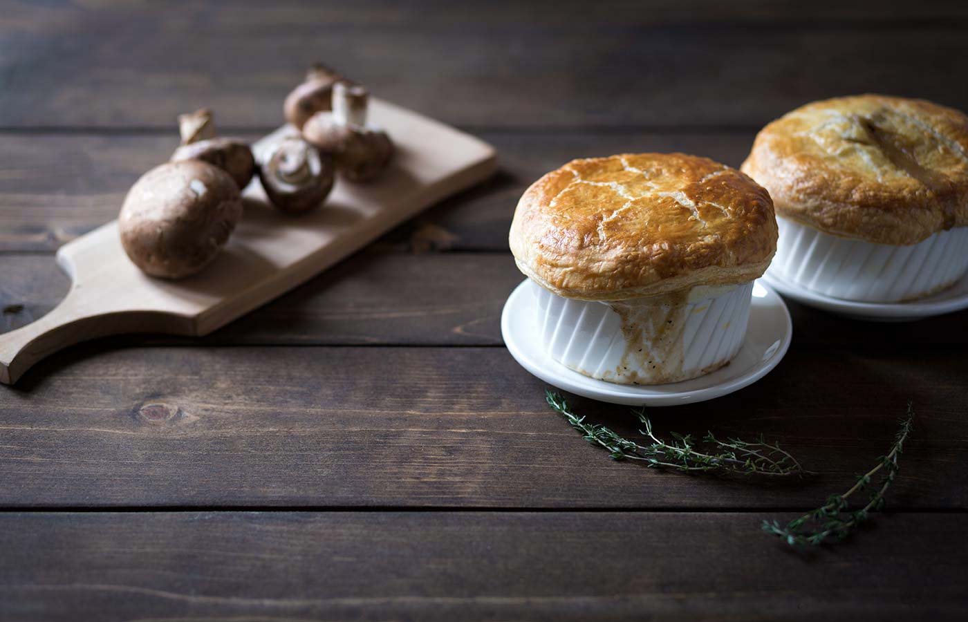 This rich, creamy Mushroom Pot Pie is topped with a flaky, tender, puff pastry crust. It's a cozy, make-ahead vegetarian meal. SavorySimple.net