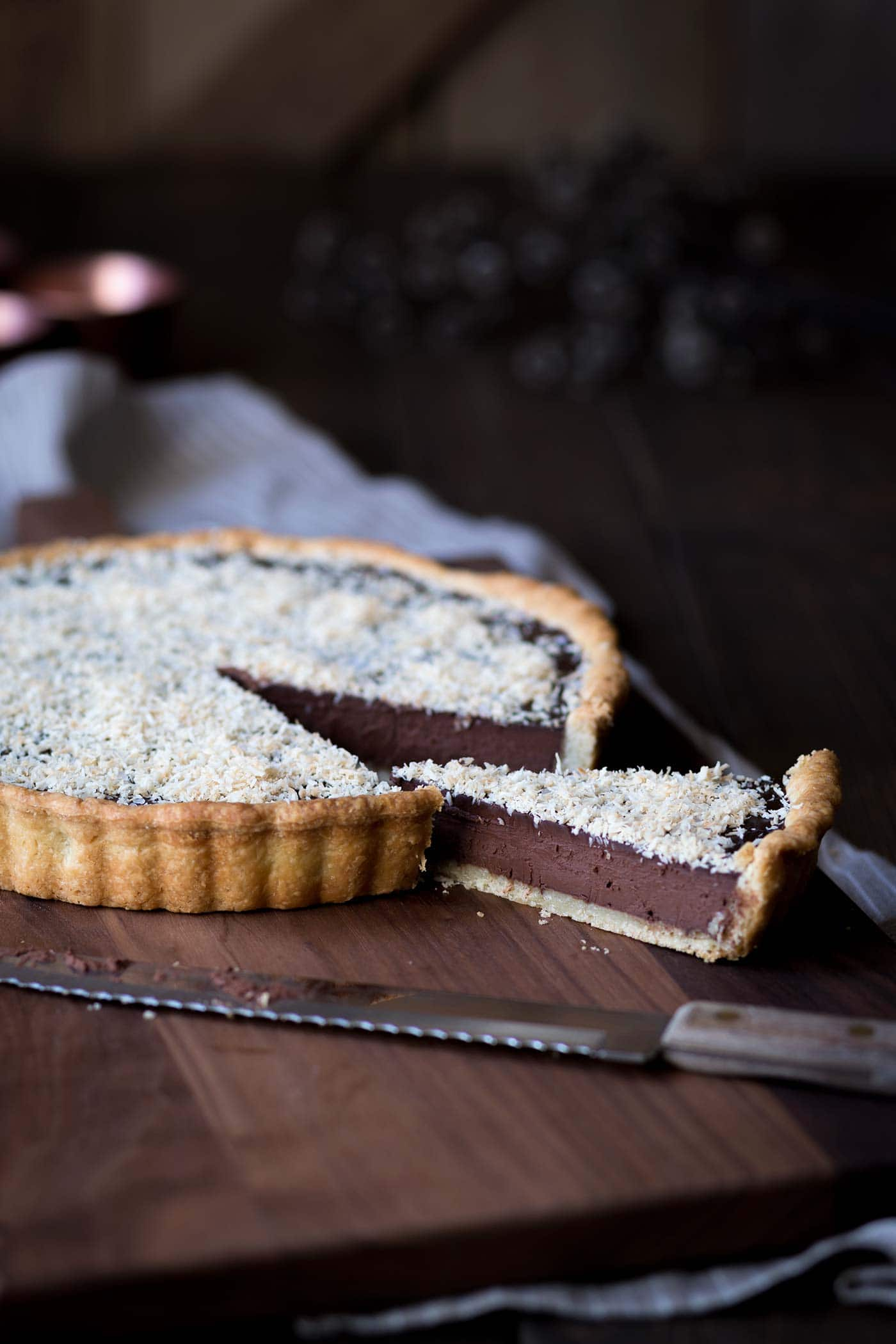 This Bittersweet Chocolate Tart with Toasted Coconut and Sea Salt is rich, decadent and perfect for parties. People will beg you for the recipe! SavorySimple.net
