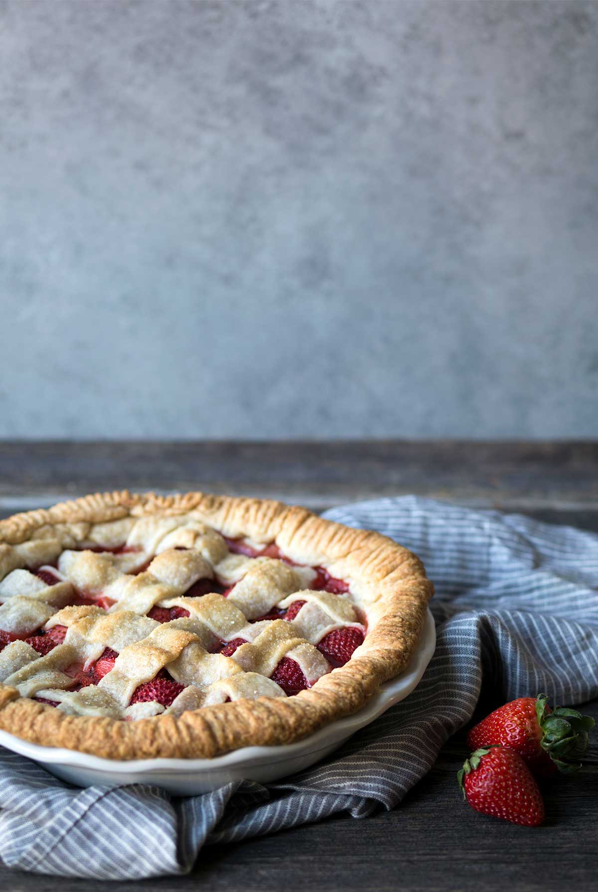 Strawberry pie recipe step by step photos savory simple fresh strawberry pie with a lattice top sitting on a blue toned napkin next to fandeluxe Images