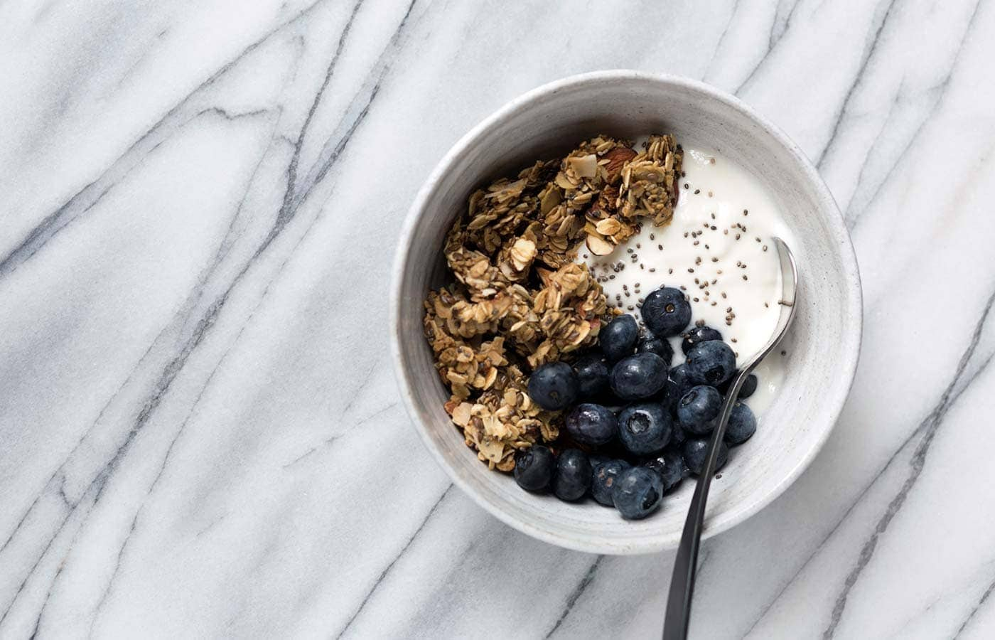This Granola Yogurt Breakfast Bowl features an easy homemade granola that can be prepared in advanced for weeks worth of quick, delicious, healthy breakfasts. SavorySimple.net