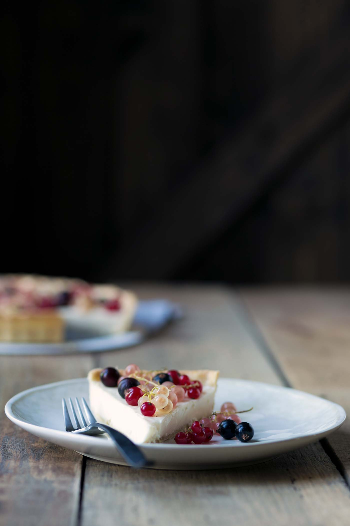 This Mixed Currant Panna Cotta Tart is a light, beautiful dessert that will wow your guests! SavorySimple.net