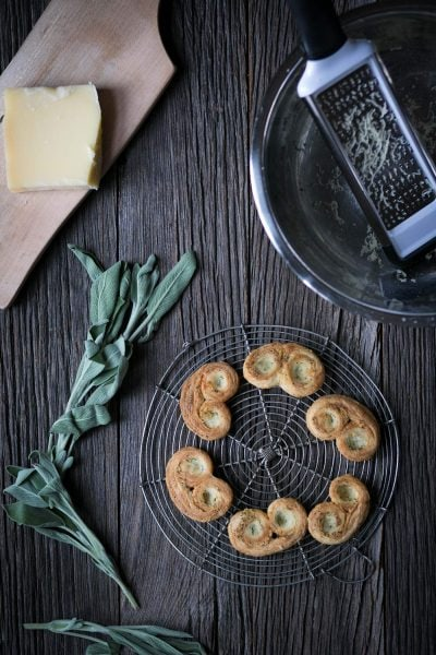 Savory Palmiers with Cheese and Herbs are perfect party food! Prepare them in advance and serve at room temperature with wine or cocktails.
