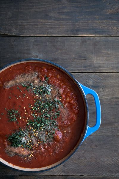 A photo of tomato sauce is a dutch oven.