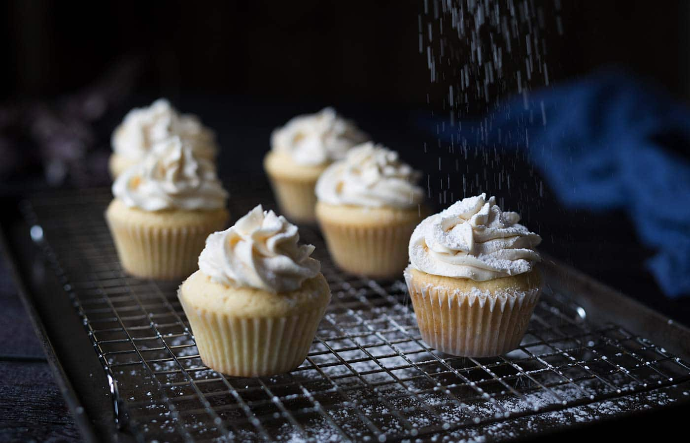 These Vanilla Maple Whiskey Cupcakes are a boozy delight, with a buttery maple center and a vanilla whiskey buttercream. Get the recipe from Savory Simple!