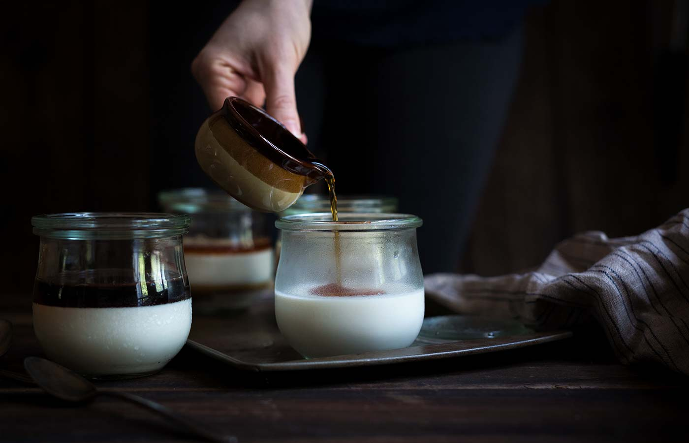 Milk Panna Cotta with Coffee Syrup is an elegant dessert that's easy to prepare. We're talking about 15 minutes total of prep/cook time, and the rest is just letting it chill. Wow your guests with minimal effort!