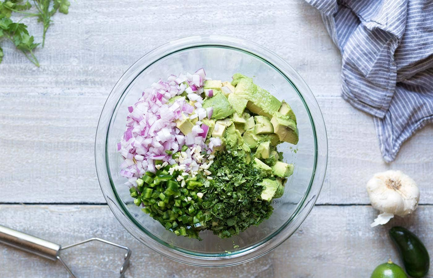 Learn how to make perfect guacamole that will stay fresh and bright green for days! Get the recipe and technique from Savory Simple.