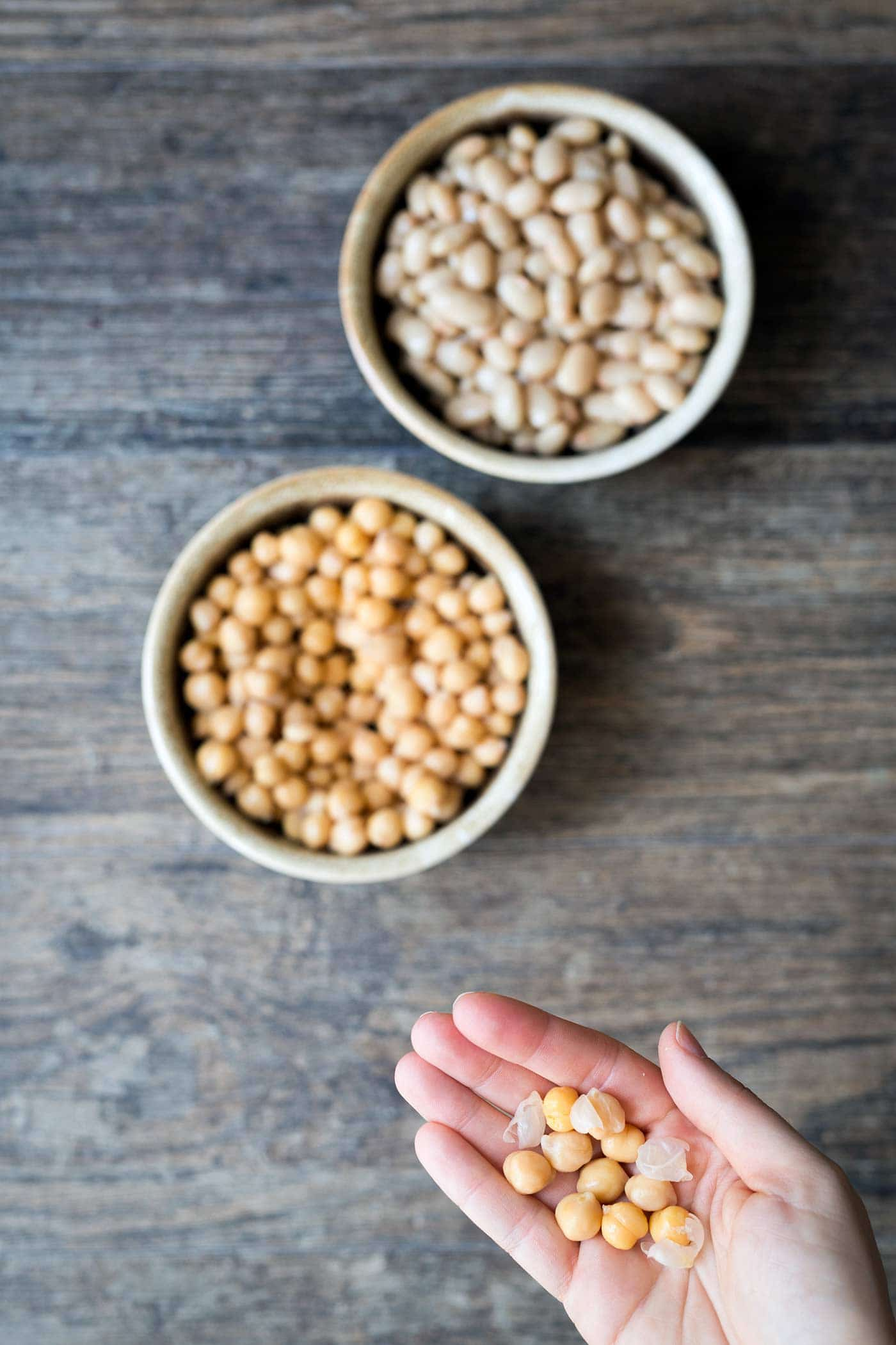 Chickpeas and white beans, with a close up of chickpea skins.