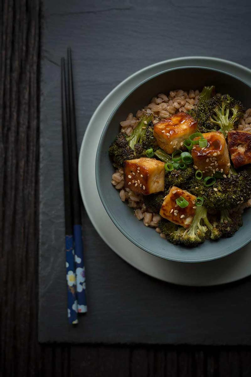 Crispy baked tofu recipe in a bowl with chopsticks