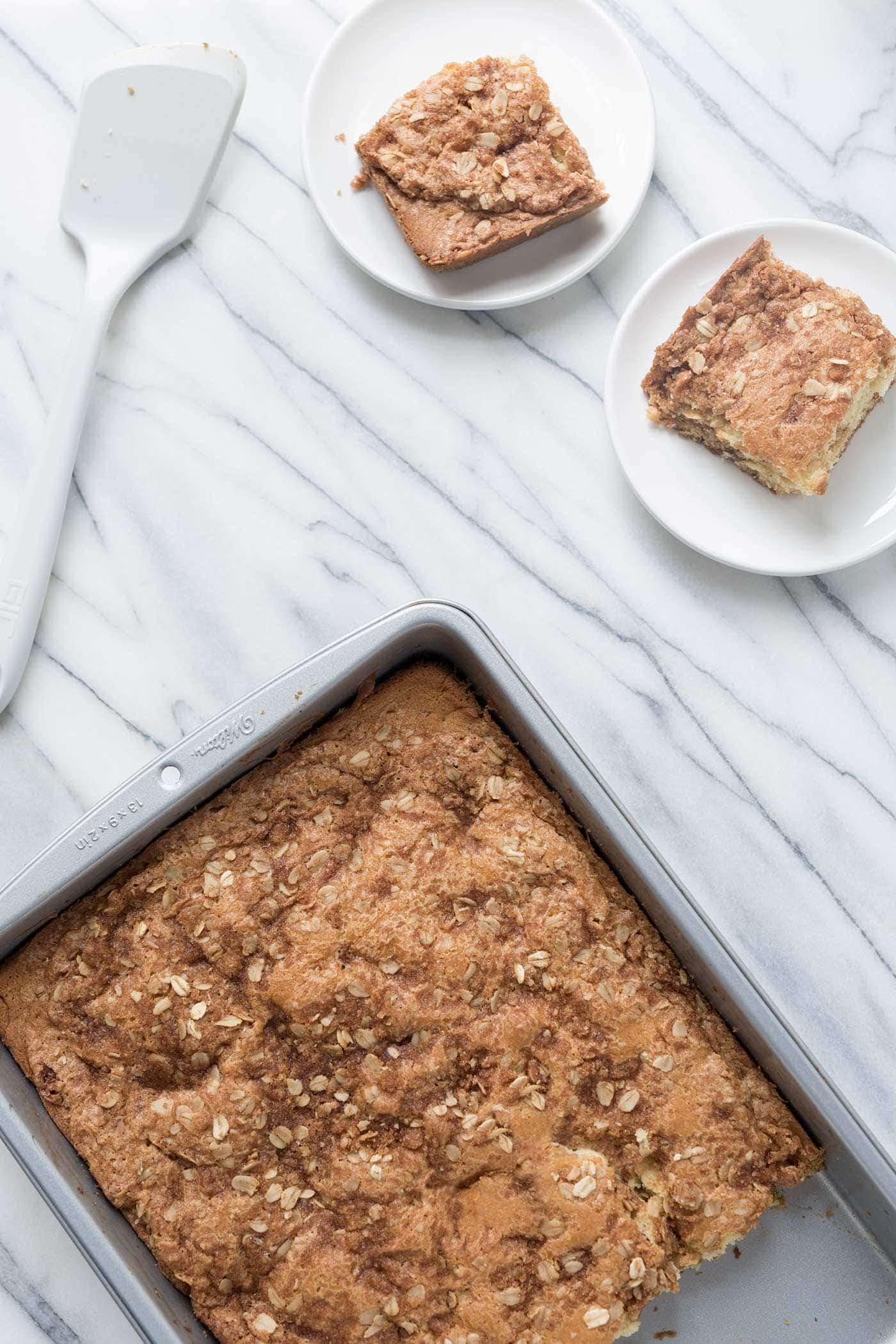 A photo of prepared sour cream coffee cake plus two slices.
