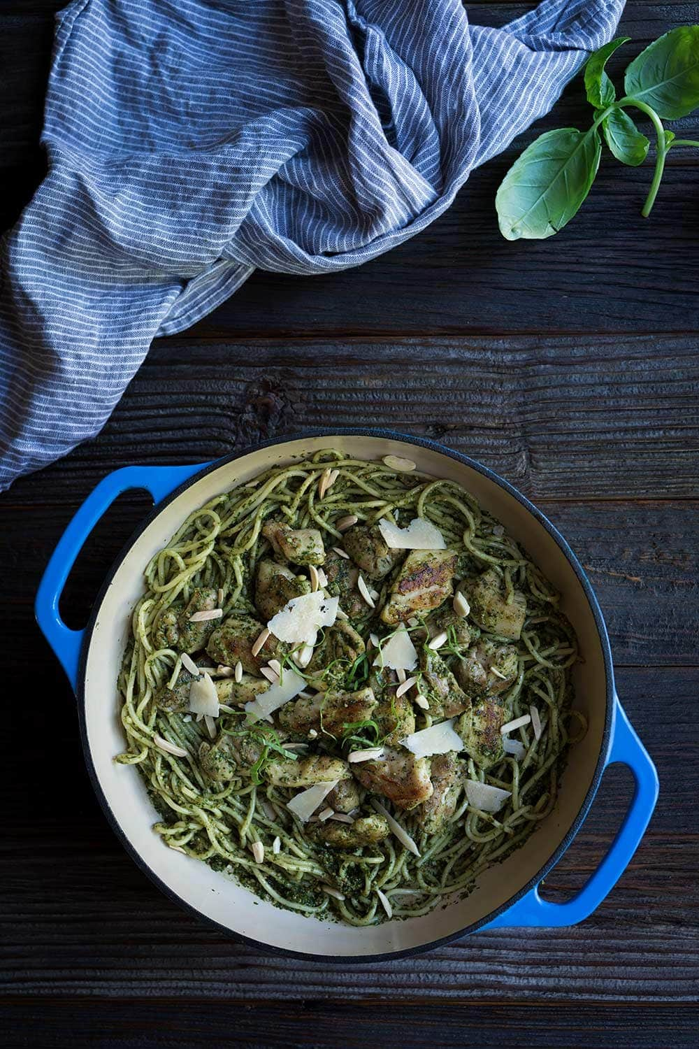 A photo of chicken pesto pasta in a blue cast iron skillet.