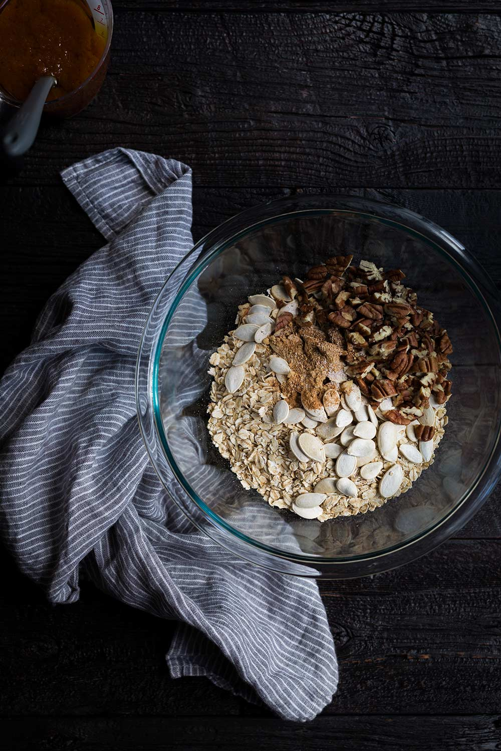 A photo of dry granola ingredients ready to be combined with the wet ingredients.