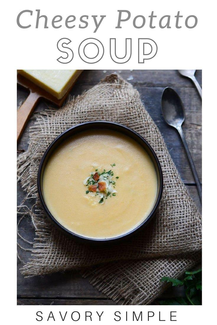 Cheesy potato soup with text overlay.
