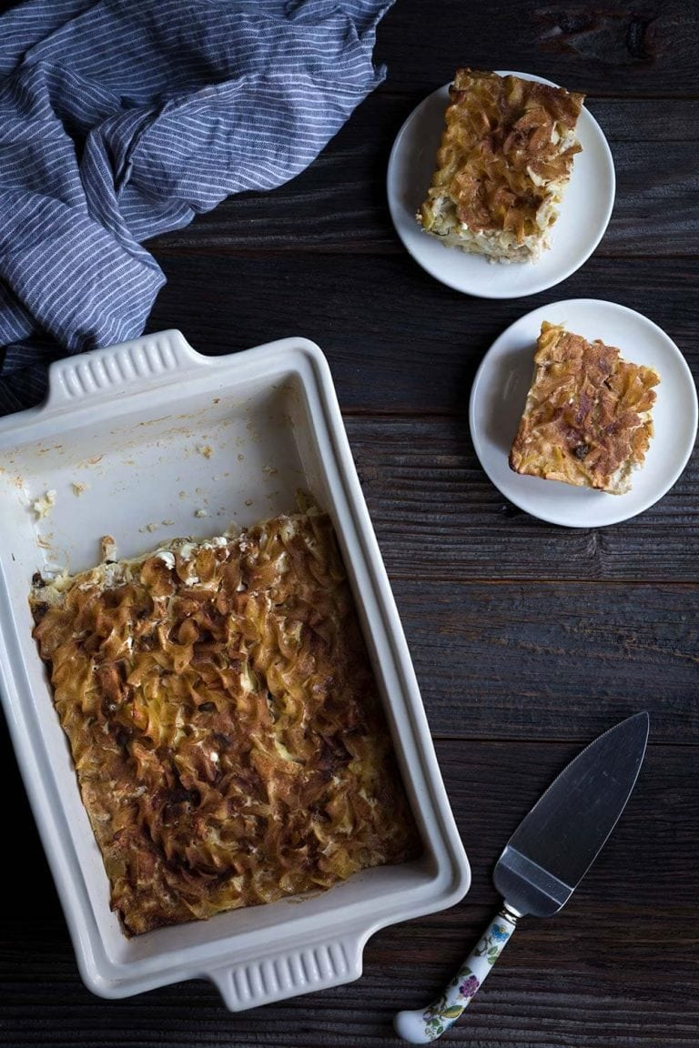 This sweet Apple Noodle Kugel recipe is perfect for celebrating Jewish holidays including Chanukah and Passover! Sour cream, cottage cheese, and a cinnamon-sugar topping help make this a perfect comfort food dish.